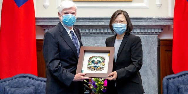 In this photo released by the Taiwan Presidential Office, Taiwan President Tsai Ing-wen, right, poses for photos with former U.S. senator Chris Dodd during a meeting in Taipei, Taiwan on Thursday, April 15, 2021. (Taiwan Presidential Office via AP)