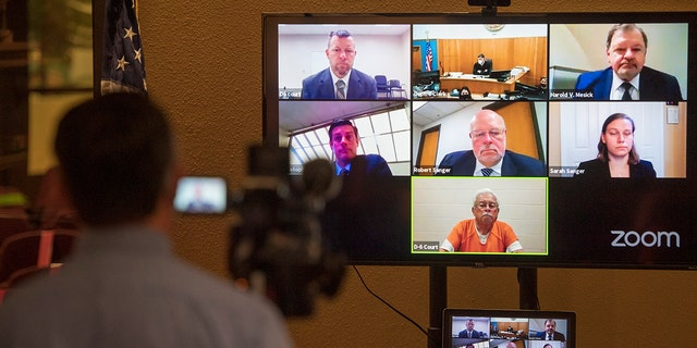 Defendants Paul Flores, top left, and his father Ruben Flores, bottom center, appear via video conference during their arraignment, Thursday, April 15, 2021, in San Luis Obispo Superior Court in San Luis Obispo, Calif. The father and son were arrested on Tuesday, April 13, 2021, in connection with the 1996 disappearance of Kristin Smart, a college student at California Polytechnic University San Luis Obispo. (AP Photo/Nic Coury)