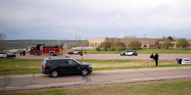 Authorities investigate the scene of an officer-involved shooting Sunday, April 18, 2021, in Burnsville, Minn.