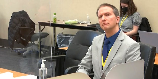 In this image from video, former Minneapolis police Officer Derek Chauvin listens as his defense attorney Eric Nelson gives closing arguments as Hennepin County Judge PeterCahill preside Monday, April 19, 2021. (Court TV via AP, Pool)