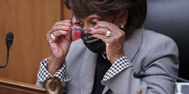 House Financial Services Committee Chairwoman Maxine Waters, D-Calif., presides over a markup of pending bills, on Capitol Hill in Washington, Tuesday, April 20, 2021. (AP Photo/J. Scott Applewhite)