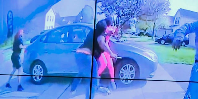 In an image from police bodycam video that the Columbus Police Department played during a news conference Tuesday night, April 20, 2021, a teenage girl, foreground, appears to wield a knife during an altercation before being shot by a police officer Tuesday, April 20, 2021, in Columbus, Ohio. (Columbus Police Department via WSYX-TV via AP)