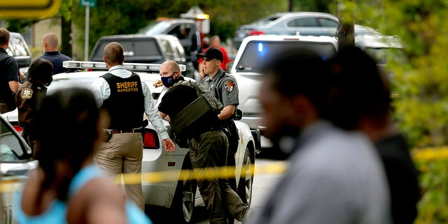 Law enforcement investigate the scene of a police involved shooting, Wednesday, April 21, 2021, in Elizabeth City, N.C. (Stephen M. Katz/The Virginian-Pilot via AP)