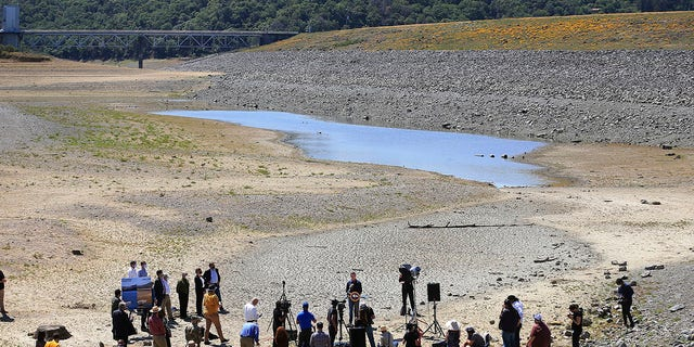 California Gov. Gavin Newsom holds a news conference in the parched basin of Lake Mendocino in Ukiah, Calif., Wednesday, April 21, 2021, where he announced he would proclaim a drought emergency for Mendocino and Sonoma counties. (Kent Porter/The Press Democrat via AP)