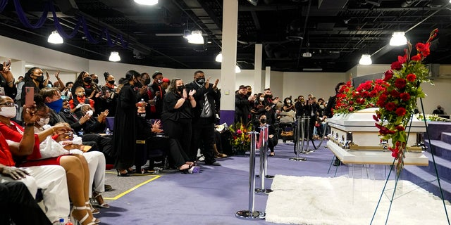 Mourners applaud during funeral services of Daunte Wright at Shiloh Temple International Ministries in Minneapolis, Thursday, April 22, 2021. Wright, 20, was fatally shot by a Brooklyn Center, Minn., police officer during a traffic stop. (AP Photo/John Minchillo, Pool)