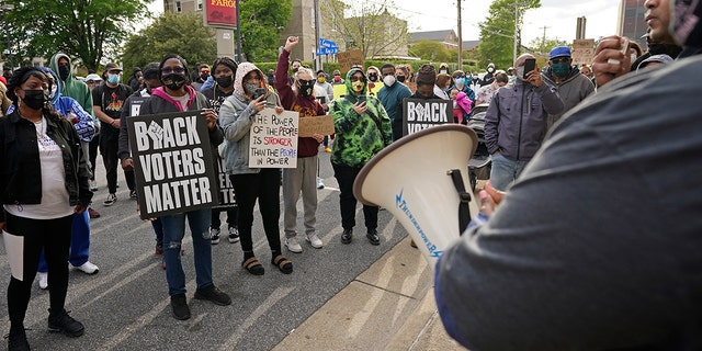People gather for a peaceful demonstration, Thursday, April 22, 2021, in Elizabeth City, N.C., protesting the shooting of Andrew Brown Jr., 42, by a deputy sheriff trying to serve a search warrant. (AP Photo/Gerry Broome)