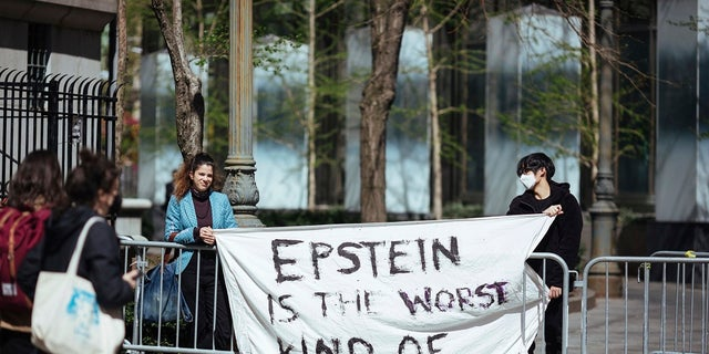 Activists protesting Jeffrey Epstein's associate Ghislaine Maxwell stand in front of a federal court in New York City. (AP Photo/Kevin Hagen)