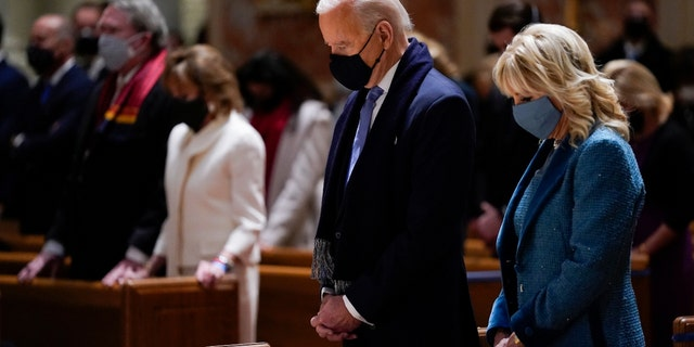 In this Wednesday, Jan. 20, 2021 file photo, President-elect Joe Biden and his wife, Jill Biden, attend Mass at the Cathedral of St. Matthew the Apostle during Inauguration Day ceremonies in Washington. (AP Photo/Evan Vucci)