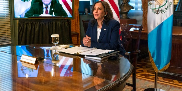 Vice President Kamala Harrismeets virtually with Guatemala's President Alejandro Giammattei, seen on screen at left, Monday, April 26, 2021, from her ceremonial office at the Eisenhower Executive Office Building on the White House complex in Washington. (AP Photo/Jacquelyn Martin)