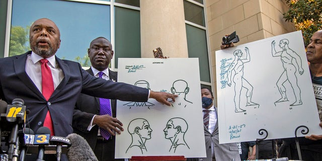 Attorneys for the family of Andrew Brown Jr., Wayne Kendall, left, and Ben Crump, center, hold a news conference Tuesday, April 27, 2021 outside the Pasquotank County Public safety building in Elizabeth City, N.C., to announce results of the autopsy they commissioned. (Travis Long/The News & Observer via AP)