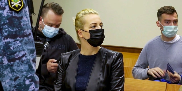 In this photo taken from a video provided by the Babuskinsky District Court on Thursday, April 29, 2021, Wife of Russian opposition leader Alexei Navalny, Yulia, centre, attends a court session with Russian opposition leader Alexei Navalny in the Babuskinsky District Court in Moscow, Russia. Navalny appeared in court via videolink from prison Thursday for an appeal against his conviction and fine for defaming a World War II veteran. Navalny was convicted in February and ordered to pay a fine of 850,000 rubles, or $11,500. (Babuskinsky District Court Press Service via AP)