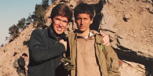 With a young Afghan soldier Tora Bora 2001