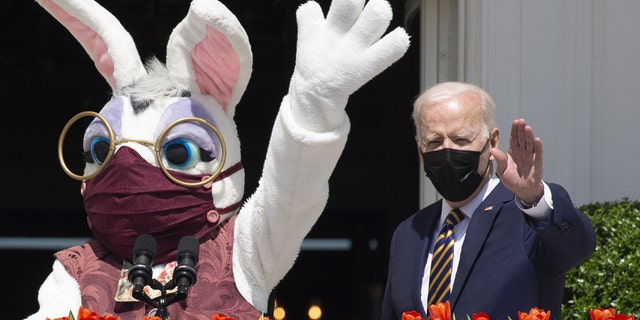President Biden, right, beside a costumed Easter bunny from the Truman Balcony of the White House in Washington, D.C., on Monday, April 5, 2021. Biden and the bunny, both outdoors, are wearing masks. (Michael Reynolds/EPA/Bloomberg via Getty Images)