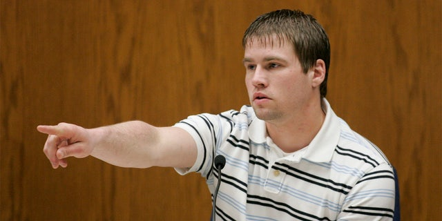 Bobby Dassey, Steven Avery's nephew and the brother of Brendan Dassey, a 17-year old also charged in Tereasa Halbach's death points out Steven Avery in the courtroom to begin his testimony at the Calumet County Courthouse during third day of Steve Avery's trial in his murder case Wednesday, Feb. 14, 2007, in Chilton, Wis. Avery is accused, along with his 17-year-old nephew, of killing Teresa Halbach, 25, after she went to the family's rural salvage lot to photograph a minivan they had for sale. (AP Photo/Sheboygan Press, Bruce Halmo, Pool)