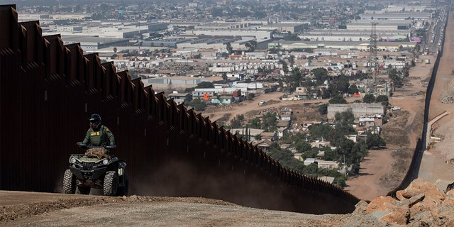 A border patrol agent patrols along a construction site for the secondary border fence which follows the length of the primary border fence that separates the United States and Mexico in the San Diego Sector on August 22, 2019 in San Diego, CA. (Photo by Carolyn Van Houten/The Washington Post via Getty Images)