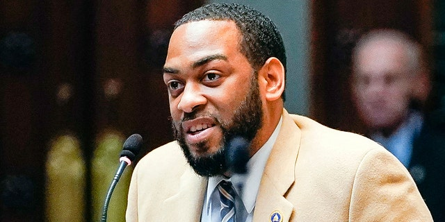 FILE - In this Feb. 19, 2020, file photo, state Rep. Charles Booker advocates for the passage of Kentucky HB-12 on the floor of the House of Representatives in the State Capitol in Frankfort, Ky. (AP Photo/Bryan Woolston, File)