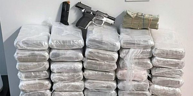 One loaded handgun and more than $200,000 were also recovered from a seventh-floor apartment in a two-building 17 story residential complex containing a gym, lap pool and roof deck.