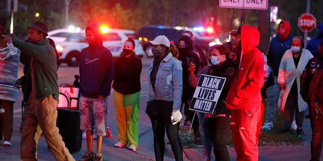 A crowd gathers to protest in the neighborhood where a Columbus police officer fatally shot a teenage girl Tuesday in Columbus