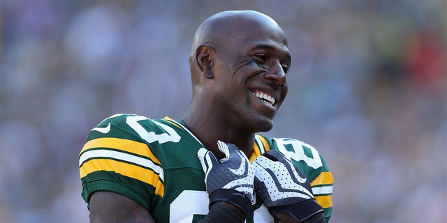 GREEN BAY, WI - SEPTEMBER 30: Wide receiver Donald Driver #80 of the Green Bay Packers smiles from the sideline during the game against the New Orleans Saints at Lambeau Field on September 30, 2012 in Green Bay, Wisconsin. (Photo by Jeff Gross/Getty Images)