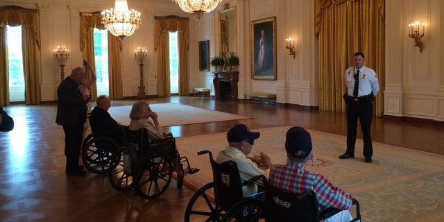 Sgt. Jonathan Stockeland showing World War II veterans around the White House. The 2017 tour included survivors of the USS Arizona.