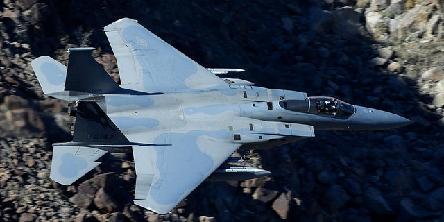 In this Feb. 28, 2017, photo, an F-15C Eagle from the California Air National Guard, 144th Fighter Wing, flies through the nicknamed Star Wars Canyon over Death Valley National Park, Calif. (AP Photo/Ben Margot)