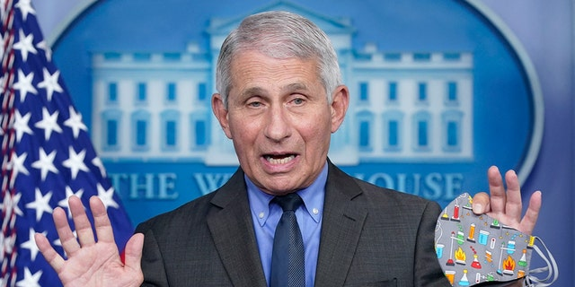 """Dr. Anthony Fauci, director of the National Institute of Allergy and Infectious Diseases, speaks during a press briefing at the White House, Tuesday, April 13, 2021, in Washington. Fauci said Sunday that the risk of catching the coronavirus outdoors is """"really quite<br> low"""" and that the CDC may issue relaxed guidance on wearing masks outdoors this week. (AP Photo/Patrick Semansky)"""