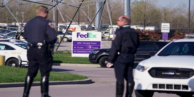 Police stand near the scene in Indianapolis where multiple people were shot at a FedEx Ground facility. (AP)
