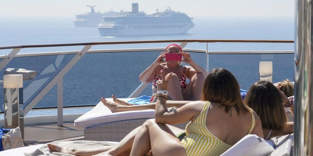 """After cruise ships were early sources of highly publicized coronavirus outbreaks, the Grandiosa has tried to chart a course through the pandemic with strict anti-virus protocols approved by Italian authorities that seek to create a """"health bubble"""" on board. (AP Photo/Andrew Medichini)"""