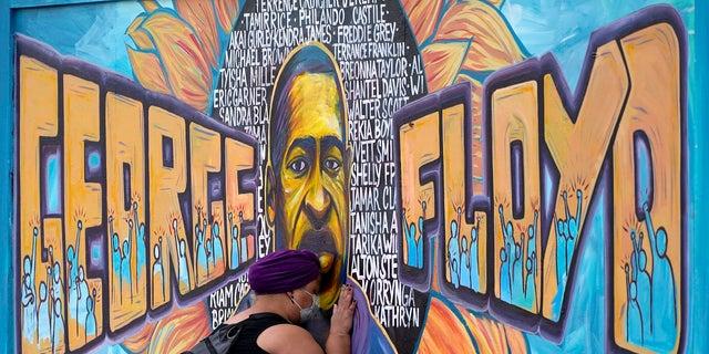 A George Floyd mural in Minneapolis, Minn. (AP)