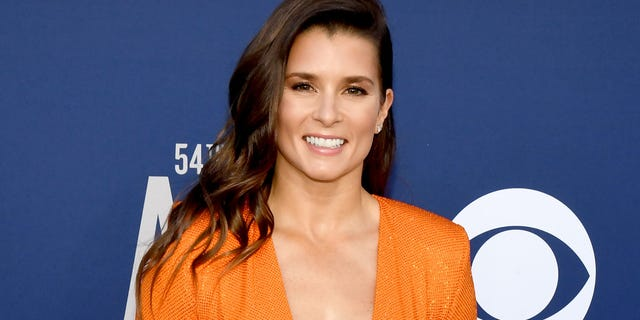 Danica Patrick kisses new man Carter Comstock in adorable beach pics.jpg