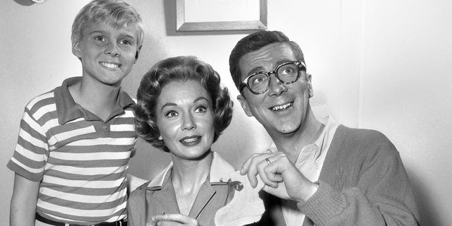 Gloria Henry (center) starred as Alice Mitchell in the CBS sitcom 'Dennis the Menace' alongside Jay North (left, as Dennis Mitchell) and Herbert Anderson (right, as Henry Mitchell).