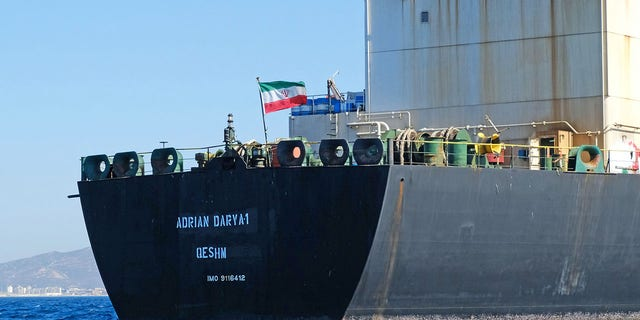 FILE - An Iranian flag flutters on board the Adrian Darya oil tanker, formerly known as Grace 1, off the coast of Gibraltar on August 18, 2019. (Photo by JOHNNY BUGEJA/AFP via Getty Images)