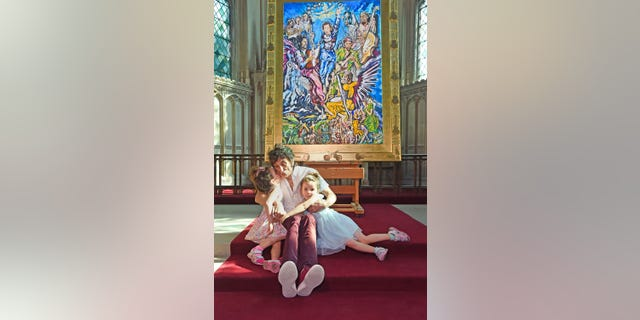Ronnie Wood poses his artwork, as well as twins Alice and Gracie.