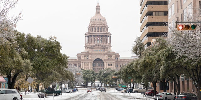 A snow-covered road near the Texas State Capitol Building in Austin, Texas, U.S., on Wednesday, Feb. 17, 2021. Photographer: Thomas Ryan Allison/Bloomberg via Getty Images