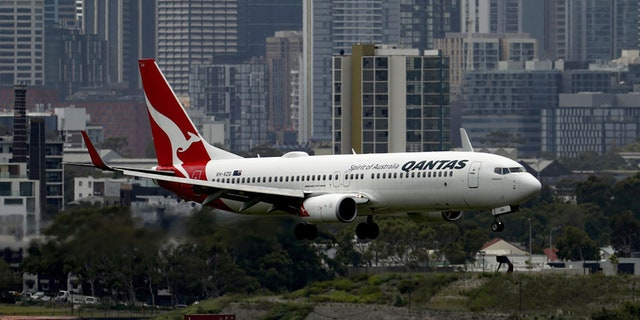An aircraft operated by Qantas Airways Ltd. prepares to land at Sydney Airport in Sydney, Australia, on Wednesday, Feb. 17, 2021. Brendon Thorne/Bloomberg via Getty Images