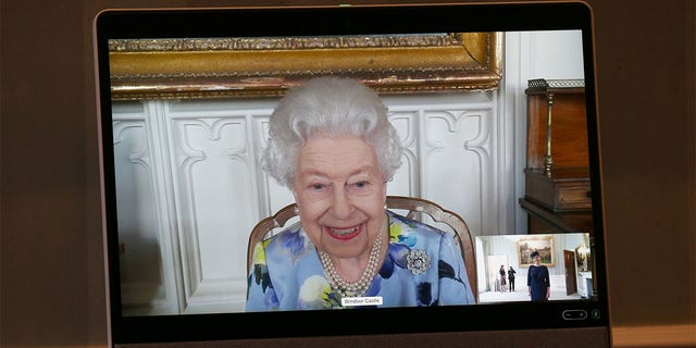 Queen Elizabeth II appears on a screen by videolink from Windsor Castle, where she is in residence, during a virtual audience to receive Her Excellency Ivita Burmistre, the Ambassador of Latvia at Buckingham Palace on April 27, 2021, in London, England.