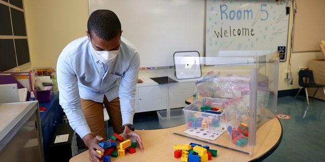 Bryant Elementary School kindergarten teacher Chris Johnson sets up his classroom on April 09, 2021 in San Francisco, California.