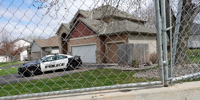 Barricades, security fencing and police officers protect the home of former Brooklyn Center police Officer Kimberly Potter on April 14, 2021 in Champlin, Minnesota. (Photo by Scott Olson/Getty Images)