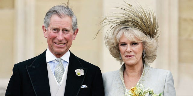 HRH the Prince of Wales, Prince Charles, and The Duchess Of Cornwall, Camilla Parker Bowles in silk dress by Robinson Valentine and head-dress by Philip Treacy, leaves the Service of Prayer and Dedication blessing their marriage at Windsor Castle on April 9, 2005, in Berkshire, England.