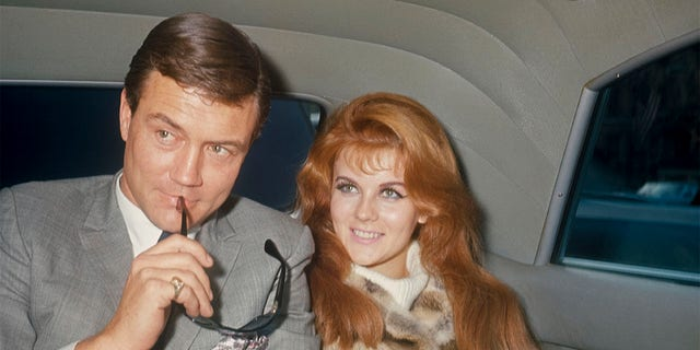 Roger Smith and Ann-Margret in the back of a limo; circa 1970; New York.