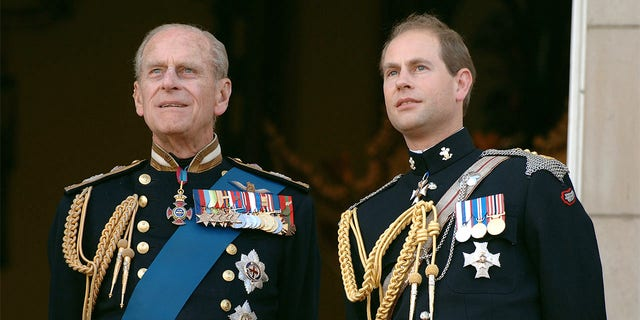 LONDON - JULY 10: Prince Edward, Earl of Wessex and Prince Philp, Duke of Edinburgh watch the flypast over the Mall of British and US World War II aircraft from the balcony of Buckingham Palace on National Commemoration Day, July 10, 2005, in London, England. (Photo by Anwar Hussein/Getty Images)