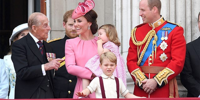 Prince Philip, Duke of Edinburgh, Catherine, Duchess of Cambridge, Princess Charlotte of Cambridge, Prince George of Cambridge and Prince William, Duke of Cambridge look on from the balcony during the annual Trooping The Colour parade at the Mall on June 17, 2017, in London, England.
