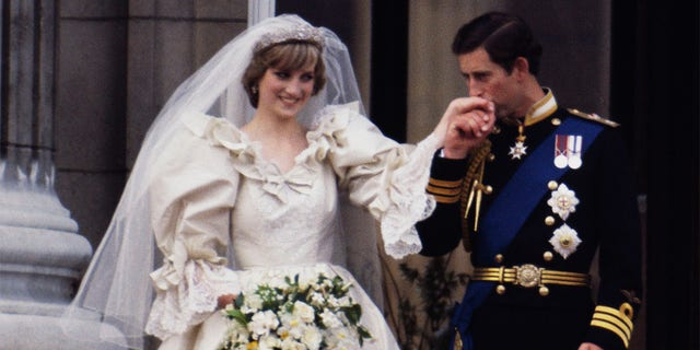 The Prince and Princess of Wales on the balcony of Buckingham Palace on their wedding day, 29th July 1981. Diana wears a wedding dress by David and Elizabeth Emmanuel and the Spencer family tiara.
