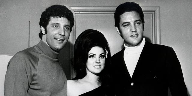 Elvis Presley (R) and Tom Jones pose for a portrait with Elvis' wife Priscilla Beaulieu Presley on April 7, 1968, in Las Vegas, Nevada.