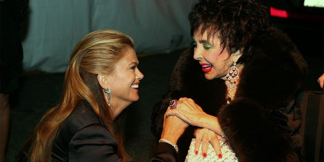 Kathy Ireland and actress Elizabeth Taylor at Macy's Passport Gala 2008 at Barker Hangar on September 25, 2008, in Santa Monica, California.