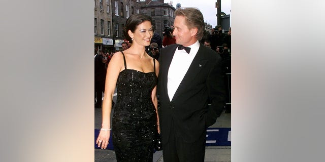 Catherine Zeta-Jones and Michael Douglas at the UK premiere of the film 'Entrapment' in 1999.
