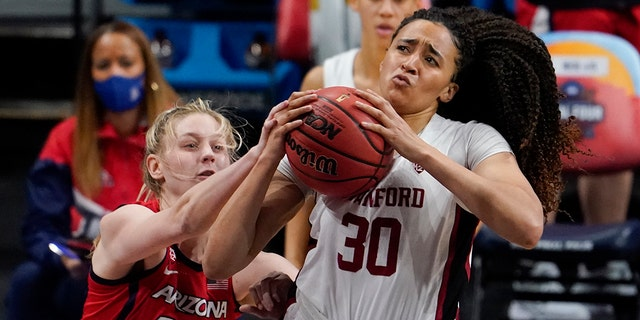 Stanford guard Haley Jones (30) drives to the basket over Arizona forward Cate Reese (25) during the first half of the championship game in the women's Final Four NCAA college basketball tournament, Sunday, April 4, 2021, at the Alamodome in San Antonio. (AP Photo/Eric Gay)