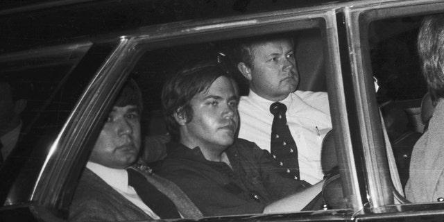 John Hinckley, Jr. (center) Getty