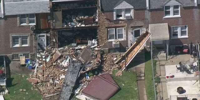 Debris from the front of the house was scattered across the front yard. (FOX29)