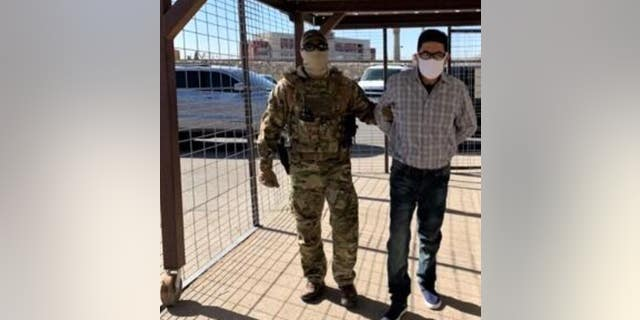 Juan Jose Bernabe Ramirez, 62, a Mexican citizen, is escorted to the U.S.-Mexico international boundary at the Paso del Norte Bridge in El Paso, Texas where he was turned over to Mexican authorities.